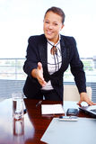 Happy business woman in the office Royalty Free Stock Photos