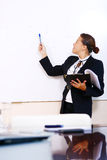 Happy business woman in the office stock photography