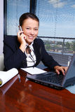Happy business woman in the office stock images