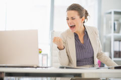 Happy business woman in office rejoicing success Stock Photo