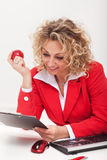 Happy business woman or office worker reading a memo Stock Photo