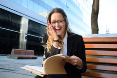 Happy business woman outside her office Stock Photo