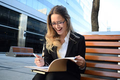 Happy business woman outside her office Stock Photos