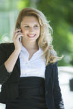 Happy business woman on the phone royalty free stock photos