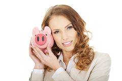 Business woman with a piggybank. Royalty Free Stock Image