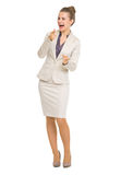 Happy business woman pointing in camera Stock Images