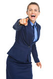 Happy business woman pointing in camera Royalty Free Stock Photo