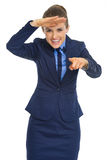 Happy business woman pointing in camera Royalty Free Stock Images