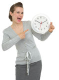Happy business woman pointing on clock Stock Photography