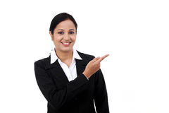 Happy business woman pointing at copy space Stock Images