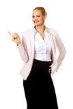Happy business woman pointing at copyspace or something Royalty Free Stock Image