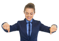 Happy business woman pointing down on copy space Royalty Free Stock Images