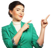 Happy business woman pointing an idea Stock Photo