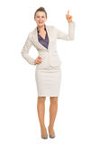 Happy business woman pointing up on copy space Royalty Free Stock Images