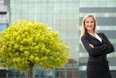 Happy business woman. Portrait of a happy business woman smiling outdoors Royalty Free Stock Image