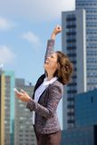 Happy business woman punching the air Stock Photography