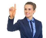 Happy business woman pushing button in the air Stock Photo