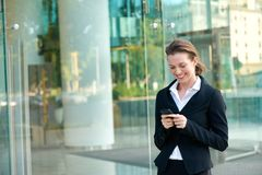 Happy business woman reading text message on mobile phone Royalty Free Stock Photo