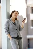 Happy business woman reading text message Royalty Free Stock Photography