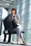 Happy business woman reading text message Stock Photos