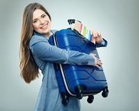 Happy business woman ready for travel with suitcase. Stock Images