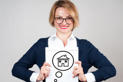 Happy business woman. Real estate agent. House dreams on paper Stock Photo