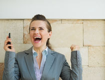 Happy business woman rejoicing success Royalty Free Stock Photos