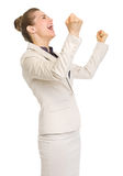 Happy business woman rejoicing success Stock Photos