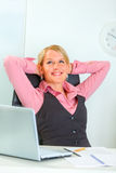 Happy business woman relaxing at office Royalty Free Stock Image