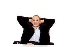 Happy business woman relaxing in office Royalty Free Stock Images