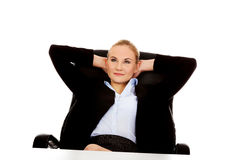 Happy business woman relaxing in office Stock Photography