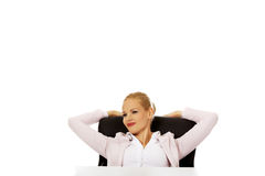 Happy business woman relaxing in office Stock Images