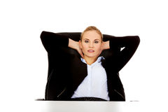 Happy business woman relaxing in office Royalty Free Stock Photography