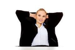 Happy business woman relaxing in office Stock Photo