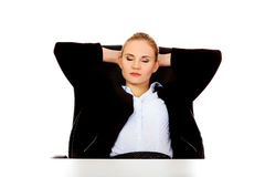 Happy business woman relaxing in office Stock Image