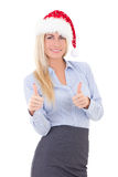 Happy business woman in santa hat thumbs up isolated on white Royalty Free Stock Photo
