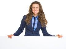 Happy business woman showing blank billboard Royalty Free Stock Photo
