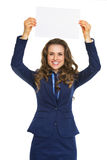 Happy business woman showing blank paper sheet Royalty Free Stock Photography