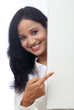 Happy business woman showing blank signboard Stock Image