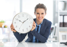 Happy business woman showing clock Stock Image