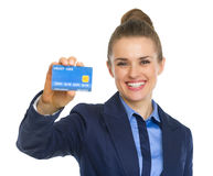 Happy business woman showing credit card Royalty Free Stock Photography