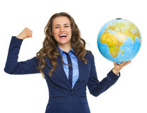 Happy business woman showing earth globe and biceps Royalty Free Stock Photo