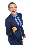 Happy business woman showing fist pump gesture Royalty Free Stock Photo