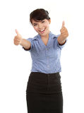 Happy business woman showing her thumbs up. Celebrating success Stock Photos