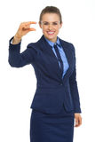 Happy business woman showing little risks Stock Photos