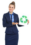 Happy business woman showing recycle sign Stock Photo