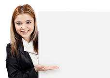 Happy business woman showing something on white board Royalty Free Stock Photography