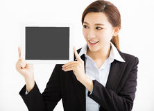 Happy Business Woman Showing the tablet. Happy asian Business Woman Showing the tablet Royalty Free Stock Image