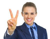 Happy business woman showing victory gesture Stock Photo