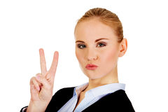 Happy business woman showing victory sign. Royalty Free Stock Photo